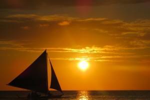 Sunset sailing boat Boracay