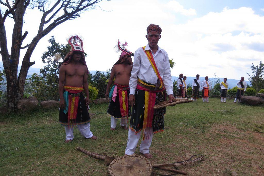 Men preparing for the Caci dance ritual