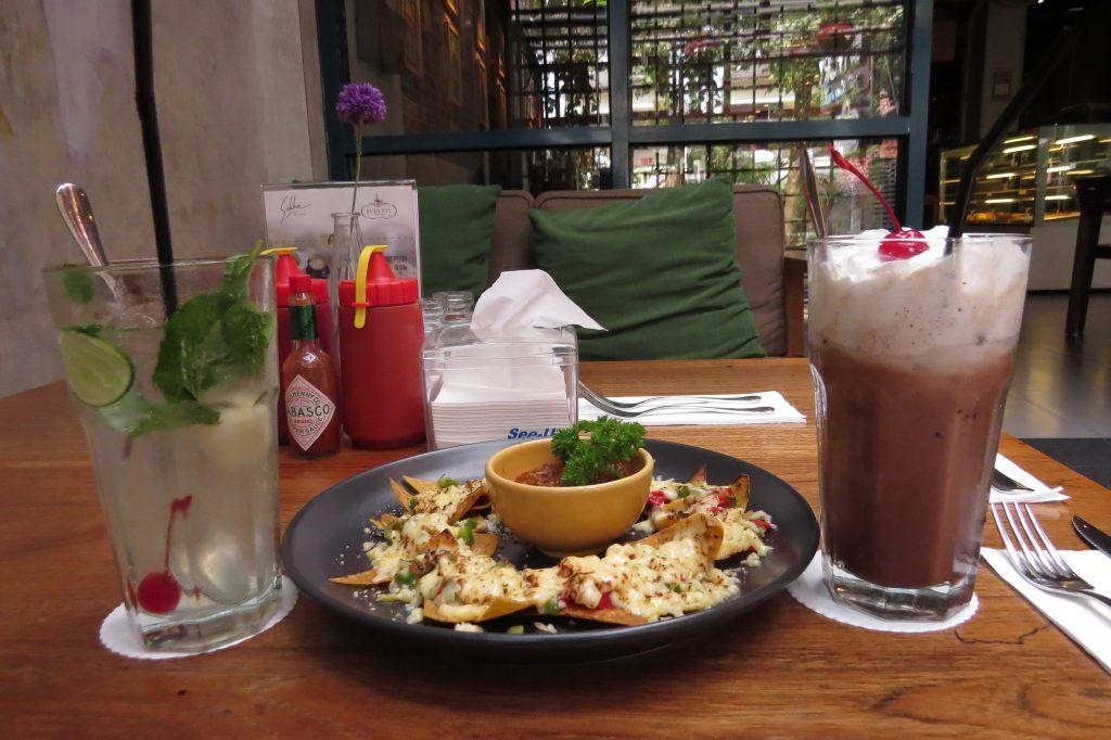 Yummy nachos with our chocolate shake and virgin mojito