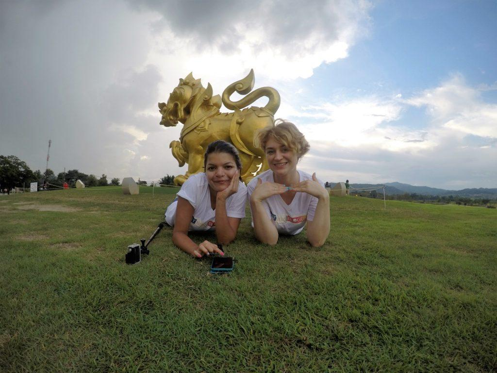 Taking selfies with the golden Singha statue
