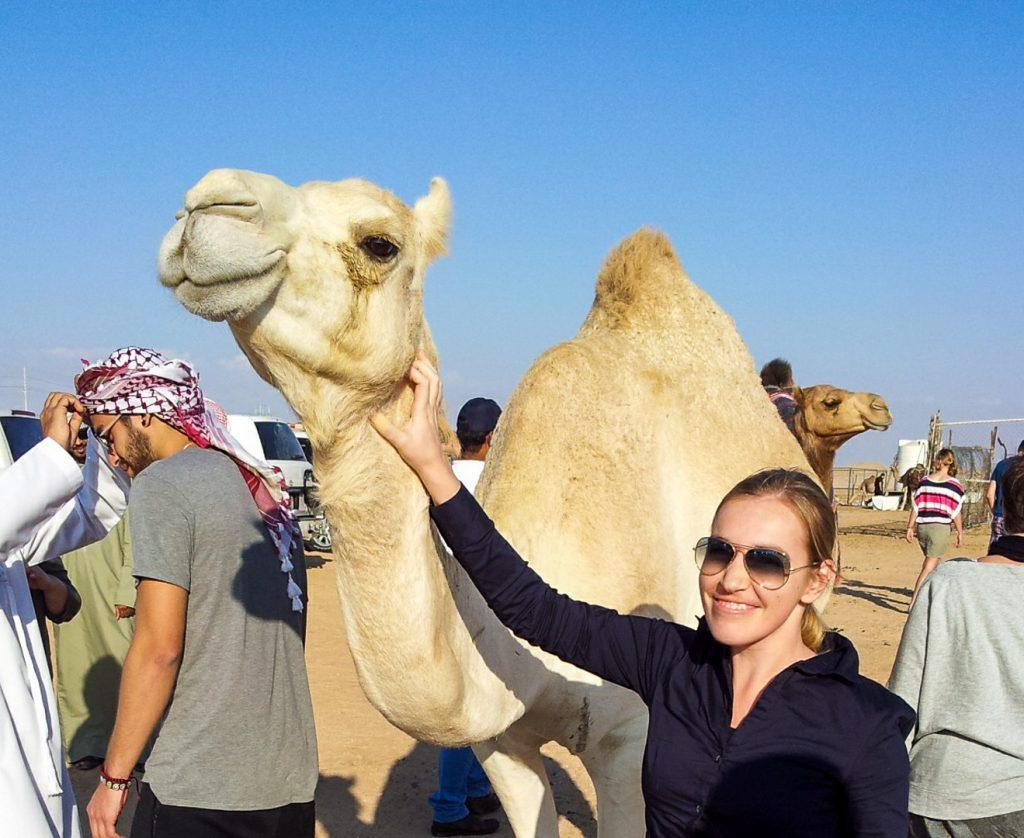 Edwina is meeting camels in Abu Dhabi instead of hanging out at a dull airport!