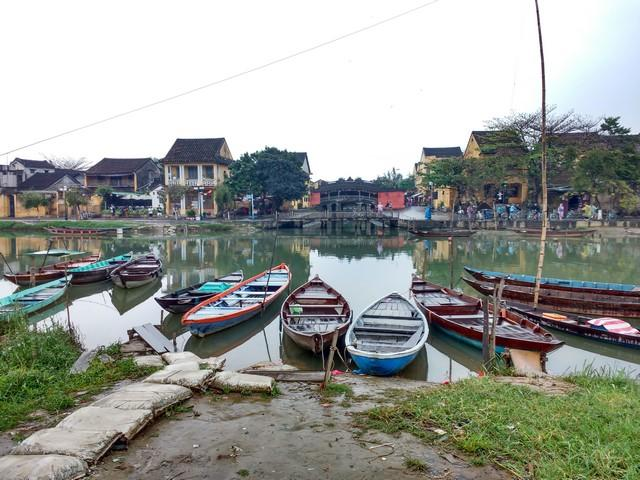 Colorful boats with a lovely view of Japanese bridge in the Ancient Town