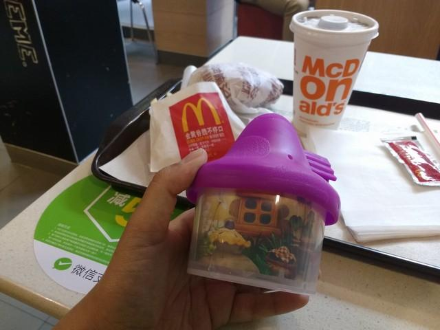 Purple smurf house with my Happy meal at McD