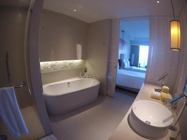 Lovely washroom with separate bathtub and shower cubicle