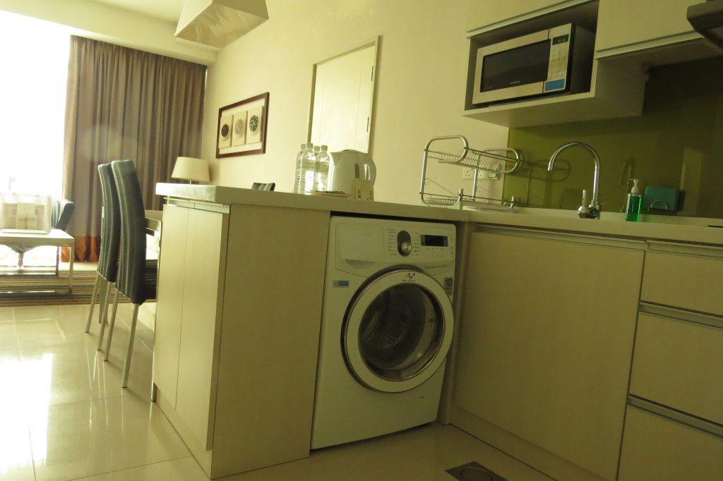 Washing machine in kitchen area