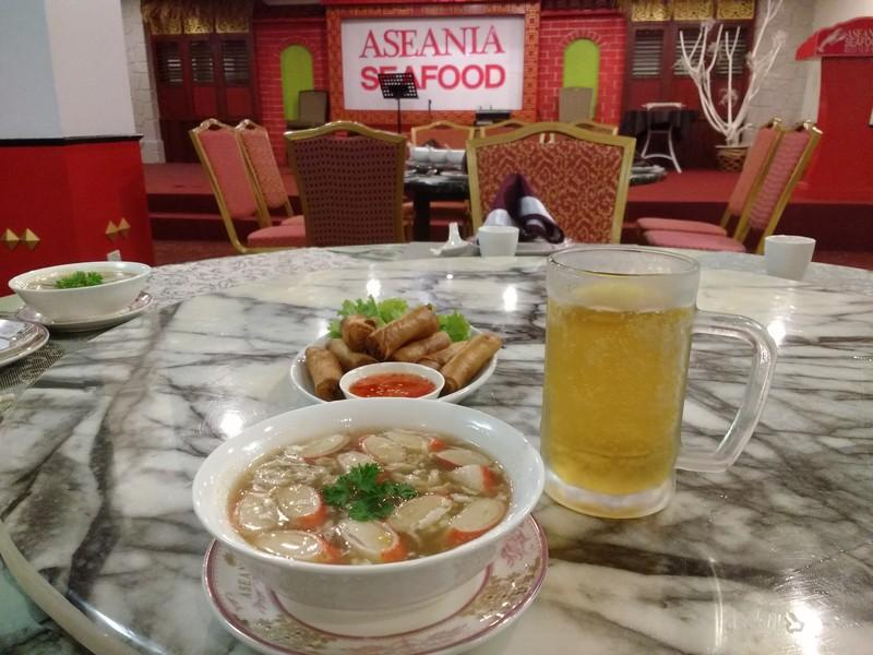 Crab meat soup and spring rolls with chilled Carlsberg beer